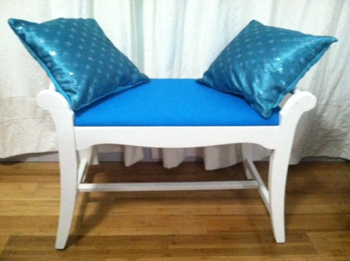 I added a bench seat (which I painted and reupholstered, then made pillows to match).
