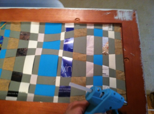 Transfer your weaving into the frame and glue the edges in place.