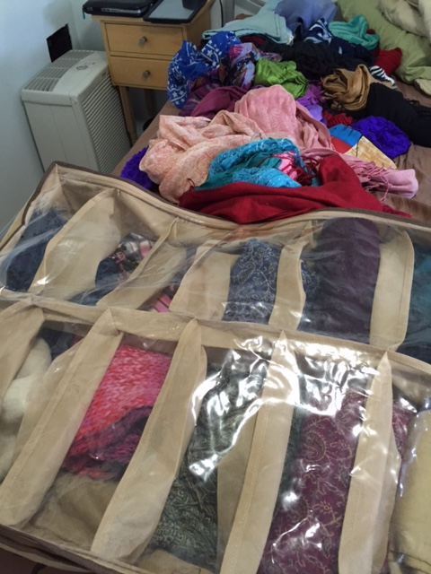 The spring scarves and the winter scarves in their under-the-bed storage container