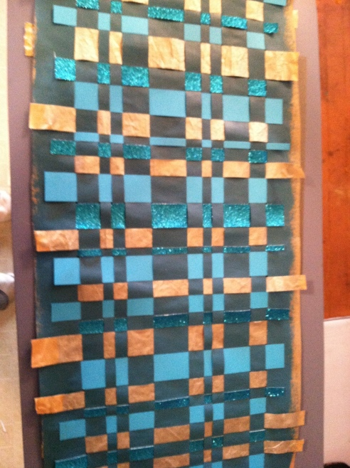 When you finish weaving, check that all of the edges are glued down. This is back of the finished product.
